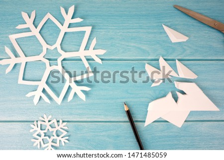 snowflakes. make cut out snowflakes day concept with selective focus. #1471485059