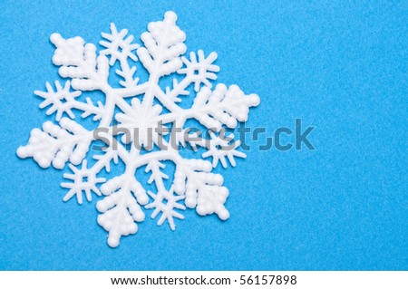 Snowflakes on Blue Background Image for Winter and Holiday Concepts.