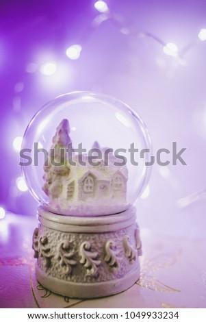 Snowglobe with purple fairy lights