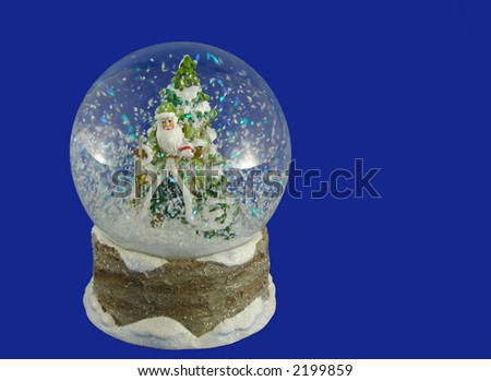 Snowglobe with Santa figure on blue background