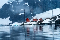 Snowing Argentine Almirante Brown Station Blue Glacier Mountain Paradise Harbor Bay Antarctic Peninsula Antarctica.  Glacier ice blue because air squeezed out of snow.