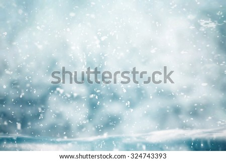Snowing in winter time with wooden table for object - Shutterstock ID 324743393