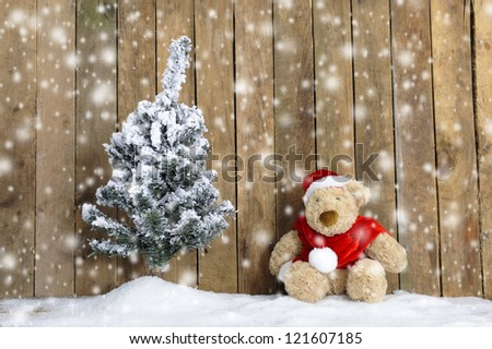 snowing on christmas bear