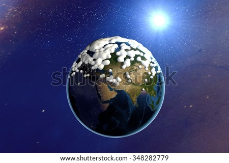 Snowing. The planet Earth from space showing India, Europe, Asia and Africa. The globe is covered with snow on space background. Fantastic background. Elements of this image furnished by NASA