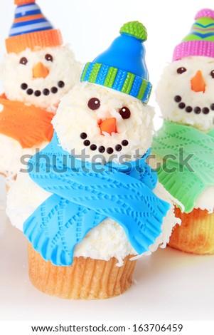 Snowman cupcakes. Studio isolated on white.