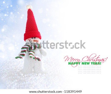 Snowman on a christmas blue background with space for text