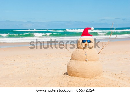 Snowman on holidays made out of sand instead of snow Concept could be used for Global Warming & Christmas Cards