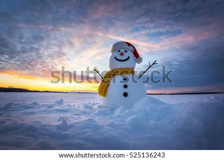 Stock Photo snowman on orange sunset background