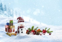 Snowman with christmas presents on snowy landscape background