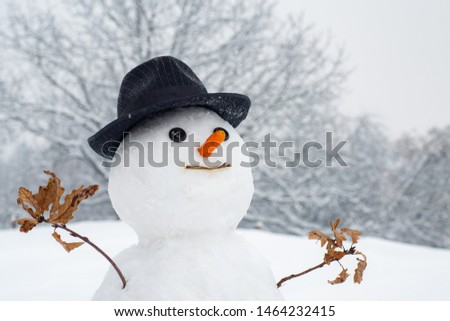 Snowman with light star in Christmas day. Snow man in winter hat. Funny snowmen. Making snowman and winter fun. Snowman gentleman in winter hat