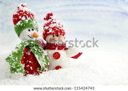 Stock Photo SNOWMEN SERIES - two smiling snowmen friends in the snow, no name toy