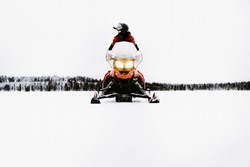Snowmobil tour in the Winterwonderland. Holidays in Finland Lapland. Beautiful snowlandscape.