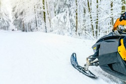 Snowmobile in white winter nature, edit space, white background
