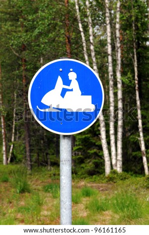 Snowmobile track in the Finnish woods - stock photo