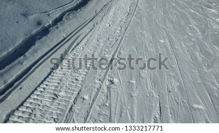 The snowmobile tracks in the snow Images and Stock Photos - Avopix com