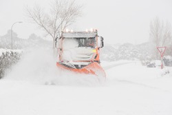 Snowplow machine covered by storm Filomena in the north of Madrid.