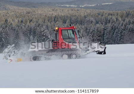 snowplow working on a ski slope