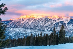 Snowshoeing tour at Purgatory Ski Resort.  Alpenglow at sundown on nearby Grizzly Peak.