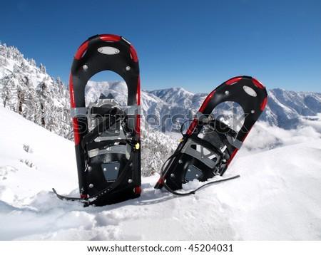 Snowshoes in a deep drift on a California mountain peak.