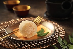 Snowskin Mooncake. New variation of mooncake; mochi dough filled custard, red bean or mung bean pastes then moulded in mooncake mould.