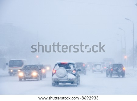 Snowstorm, poor visibility,slick roads and lots of traffic.