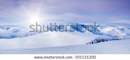 Snowy arctic mountains in sunny day.