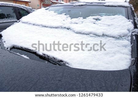Snowy car in the parking lot #1261479433