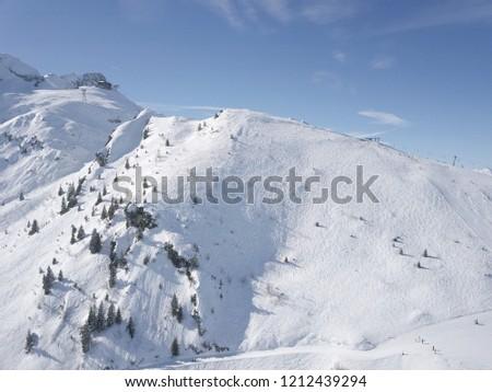 Snowy hill side with ski slopes in Garmisch #1212439294
