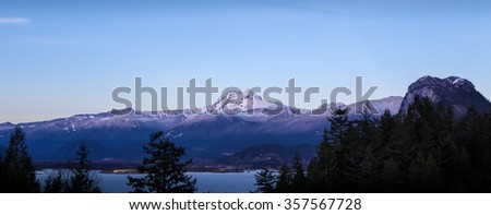 Snowy mountain peak and \'The Chief\' near Squamish, BC, at dusk.