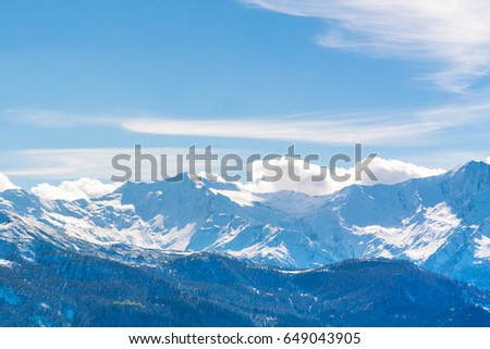 Snowy mountain peaks against the sky #649043905