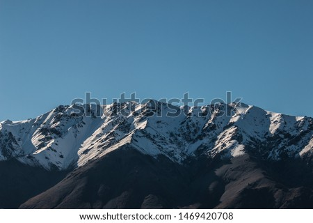 Snowy Mountain Peaks, Large High Altitude Mountains With Blue Sky Background, New Zealand Landscape, Close Up Mountains, Snow Capped Peak