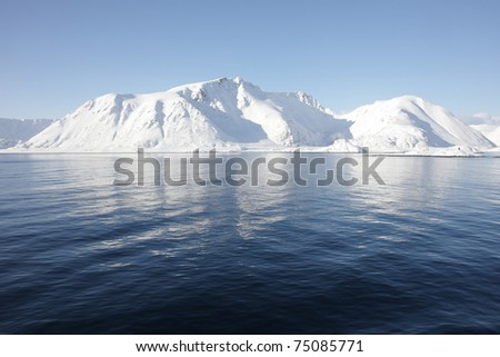 Snowy mountains at Norwegian coast