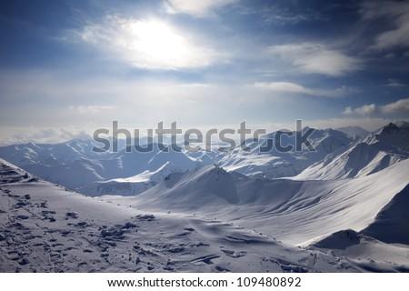 Snowy mountains in evening. Caucasus Mountains, Georgia, ski resort Gudauri.