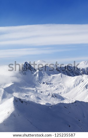 Snowy mountains in haze. Caucasus Mountains, Georgia. View from ski resort Gudauri. #125235587