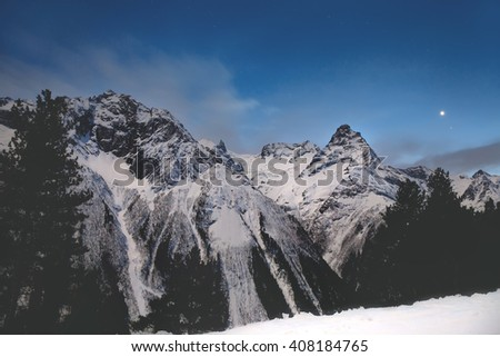 snowy mountain landscape night. snowy mountains in the moonlight and stars night winter mountain landscape 408184765 l
