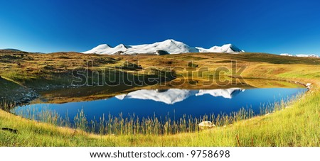 Snowy mountains reflected in lake, Plateau Ukok