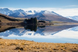 Snowy mountains reflecting on lake in Canterbury, New Zealand