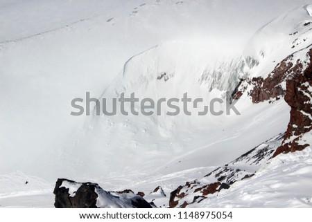 snowy mountainside avalanche glacier caucasus #1148975054