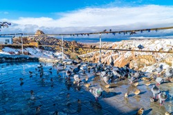Snowy panoramic view of the famous Pigeon Valley in Cappadocia, Turkey with typical fairy chimneys and pigeon houses