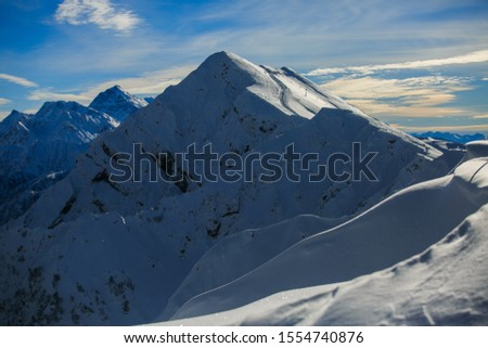 snowy peaks are visible from the peak of Rosa Khutor