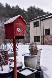 Snowy postbox on a snowy day