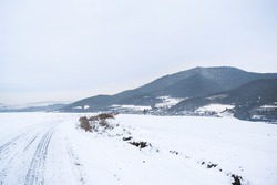 Snowy road on a hill in winter
