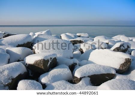 Snowy rocks of Dutch breakwater in wintertime #44892061