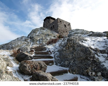 Snowy stone stairs at the Harney Peak Fire Tower in the Black Hills National Forest.