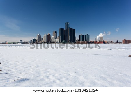 Snowy Windsor-Detroit International Riverfront with GM Renaissance Background #1318421024