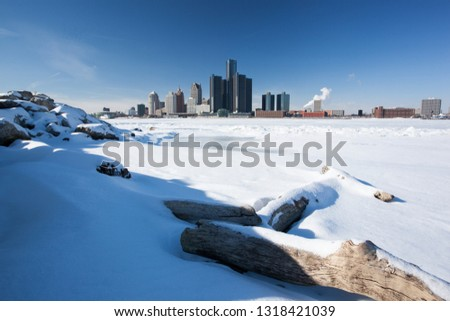 Snowy Windsor-Detroit International Riverfront with GM Renaissance Background #1318421039