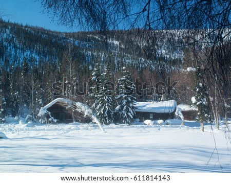 snowy winter cabins