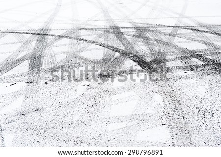 Snowy winter city road with tire trace.