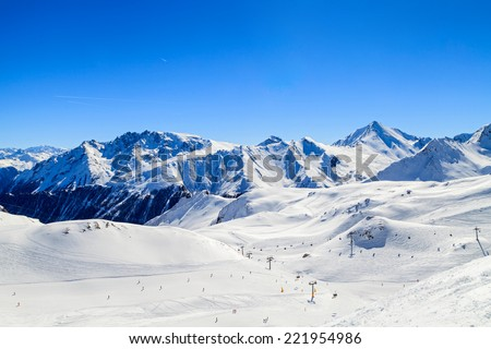 Snowy winter landscape of a ski resort in the Alps