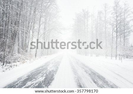 Snowy winter road during blizzard in Latvia. Heavy snow storm. #357798170